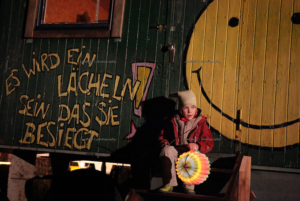 Unrest in Lüchow-Dannenberg. A kind of traditional latern march ends as a blockade on tracks. Thousands of people demonstrate against a transport of 11 Castor containers filled with high radioactive waste to Gorleben, Lower Saxony, Germany. The protest takes place shortly after the governments unpopular decision to extend the period of operation for german nuclear power plants for an additional decade.
