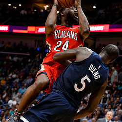 Nov 29, 2017; New Orleans, LA, USA; Minnesota Timberwolves center Gorgui Dieng (5) draws a charge from New Orleans Pelicans guard Tony Allen (24) during the second half at the Smoothie King Center. The Timberwolves defeated the Pelicans 120-102. Mandatory Credit: Derick E. Hingle-USA TODAY Sports