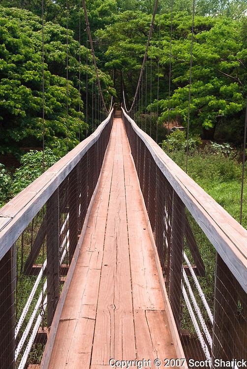 A swinging bridge on the island of Kauai, Hawaii.