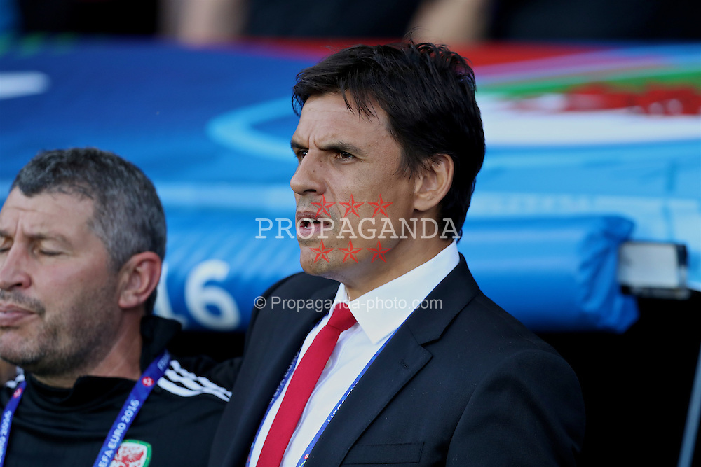 TOULOUSE, FRANCE - Monday, June 20, 2016: Wales' manager Chris Coleman sings the national anthem before the final Group B UEFA Euro 2016 Championship match against Russia at Stadium de Toulouse. (Pic by David Rawcliffe/Propaganda)