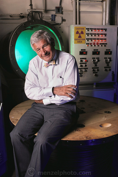 Raychem's Paul Cook outside Electron Beam accelerator radiation chamber (used for plastic pipe irradiation). Model Released.