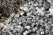 Metal recycling - scrap metal compacted into cubes -  to avoid environmental pollution in England