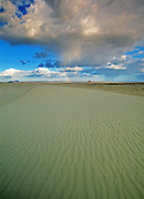 Killpecker Sand Dunes, Boars Tusk and rainbow during a spring storm in the Red Desert. Great Basin, Wyoming