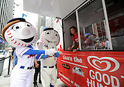 Mr and Mrs. Met line up at the Good Humor Truck, Tuesday, June 24, 2014, to receive free Good Humor ice cream bars as part of a city-wide ice cream giveaway that will take place all summer in New York City.  (Diane Bondareff/Invision for Good Humor/AP Images)