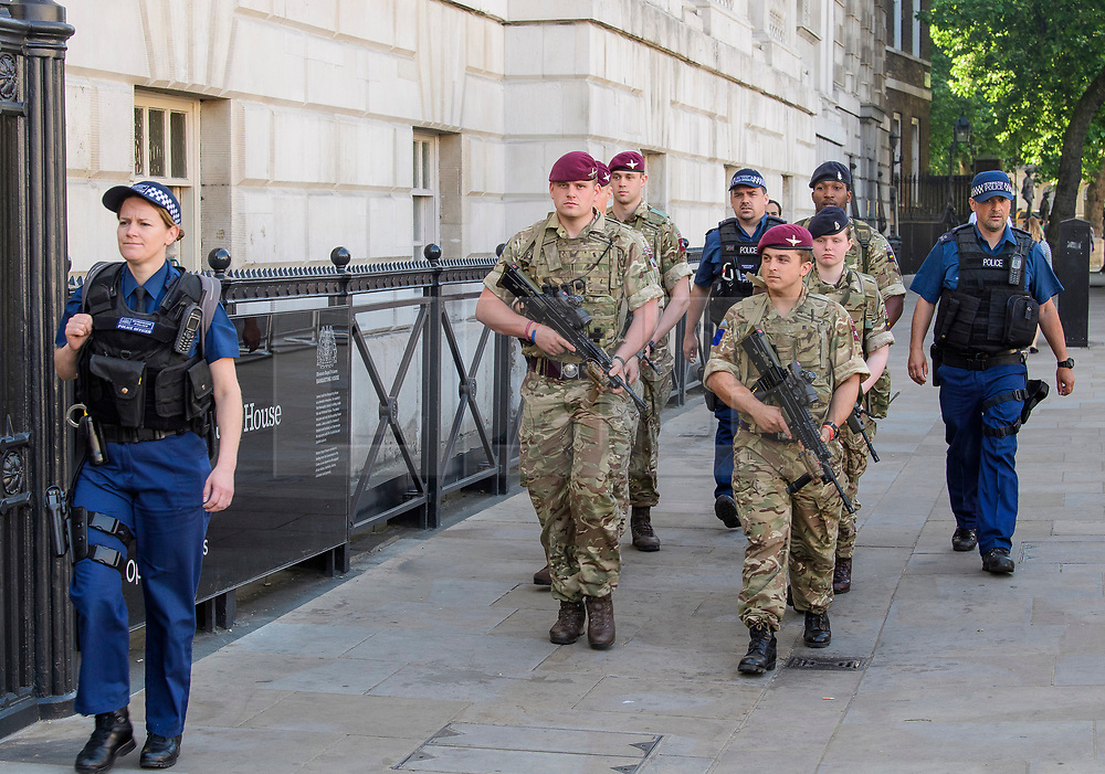 © Licensed to London News Pictures. 25/05/2017. London, UK. Armed soldiers and police in Westminster, London following a terrorist attack in Manchester, northern England, earlier this week. 23 people were killed an dozens more injured when Salman Abedi set off a suicide bomb at an Ariana Grande concert.  Photo credit: Ben Cawthra/LNP