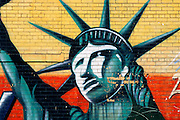 Graffiti mural of the Statue of Liberty on the Lower East Side of Manhattan, New York City.