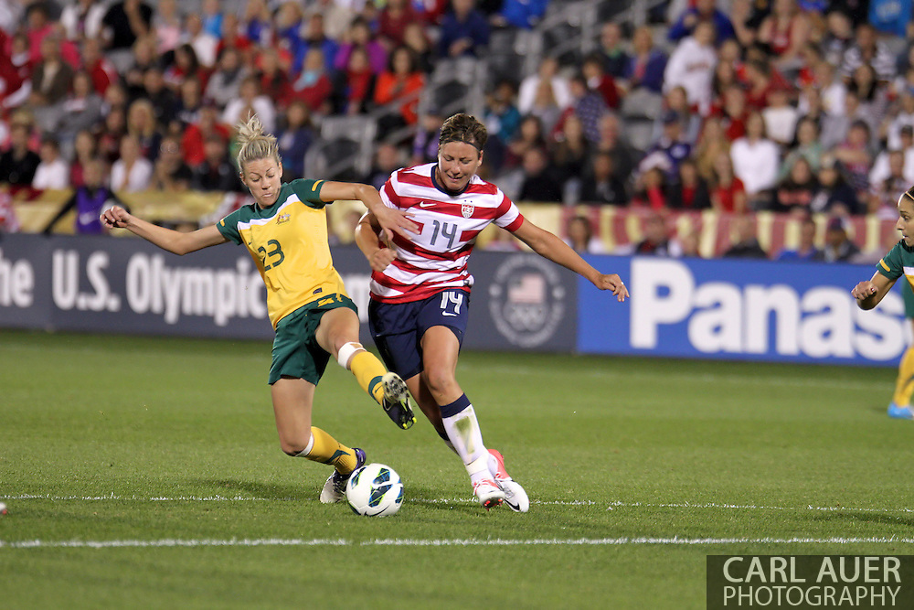 September 19, 2012 Commerce City, CO.  USA f Abby Wambach (14) gets fouled by Australia d Alanna Kennedy (23) during the Soccer Match between the USA Women's National Team and the Women's Australian team at Dick's Sporting Goods Park in Commerce City, Colorado