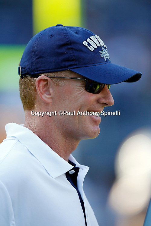 Dallas Cowboys Offensive Coordinator Jason Garrett shares a pregame laugh during a NFL week 2 preseason football game against the San Diego Chargers on Saturday, August 21, 2010 in San Diego, California. The Cowboys won the game 16-14. (©Paul Anthony Spinelli)