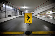 Sign of walking man in a parking house (IMF) in Washington .