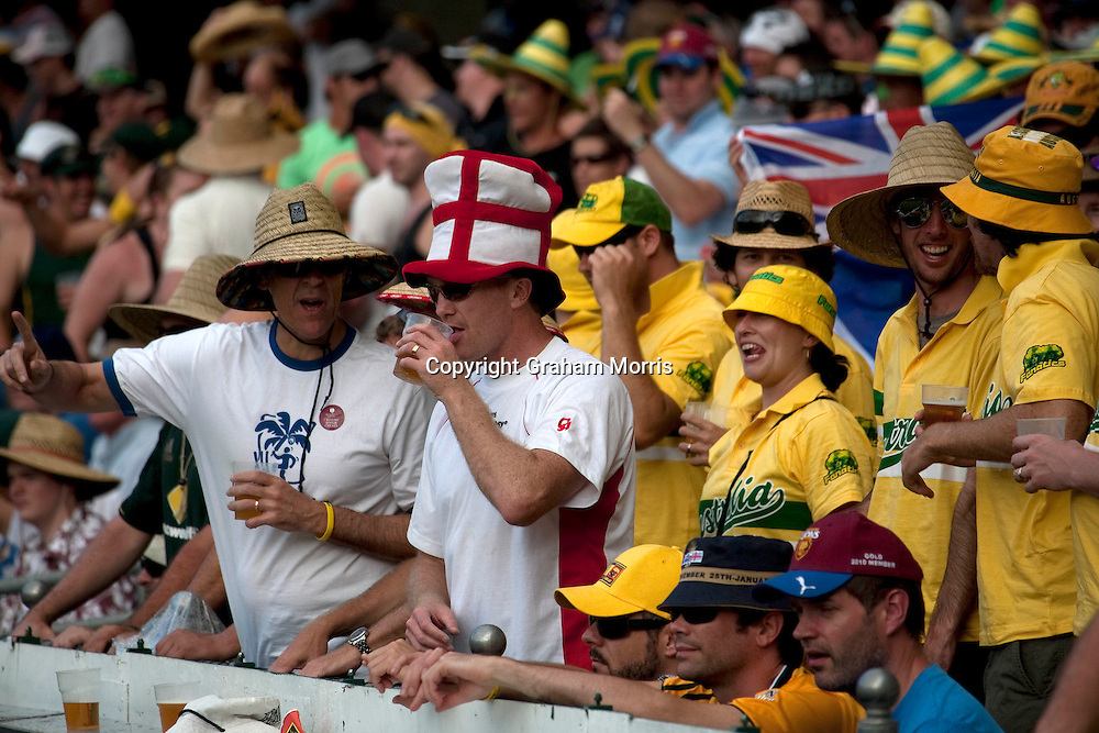 Australian and England supporters during the first Ashes Test Match between Australia and England at the Gabba, Brisbane. Photo: Graham Morris (Tel: +44(0)20 8969 4192 Email: sales@cricketpix.com) 27/11/10