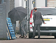 Exclusive<br /> <br /> a contestant arrives under umbrella in green jacket as friends remove suitcases at the hotel hideaway in Elstree for Celebrity Big Brother which starts on Monday evening<br /> ©Exclusivepix