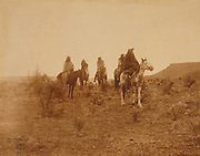 Five Native Americans on horseback in desert c1903. Photograph by Edward Curtis (1868-1952).
