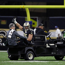 Jan 7, 2018; New Orleans, LA, USA; New Orleans Saints offensive guard Andrus Peat (75) signals thumbs up as he leaves the field after suffering an apparent injury during the second quarter in the NFC Wild Card playoff football game against the Carolina Panthers at Mercedes-Benz Superdome. Mandatory Credit: Derick E. Hingle-USA TODAY Sports
