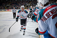 KELOWNA, CANADA - FEBRUARY 1: Devante Stephens #21 of the Kelowna Rockets celebrates a goal by high fiving teammates at the bench against the Calgary Hitmen on February 1, 2017 at Prospera Place in Kelowna, British Columbia, Canada.  (Photo by Marissa Baecker/Shoot the Breeze)  *** Local Caption ***