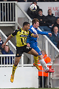 Hartlepool United striker Luke James and Joe Widdowson (Defender) Dagenham & Redbridge compete for the high ball during the Sky Bet League 2 match between Hartlepool United and Dagenham and Redbridge at Victoria Park, Hartlepool, England on 12 March 2016. Photo by George Ledger.