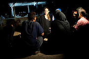 Jordan: UNHCR Special Envoy Angelina Jolie meets with refugees on the Jordanian border minutes after they crossed from Syria. With shelling clearly audible and visible across the border in Syria, some 200 refugees made the dangerous crossing under cover of night. <br /> <br /> Authorities estimate hundreds of families are fleeing the violence and seeking safety across the border every night.<br /> <br /> <br /> &copy;UNHCR/JTanner/Sept 2012