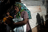 People displaced by the war between the government of Sri Lanka and the LTTE line up for medical treatment in a camp for internally displaced people at the Menick farm near Vavuniya, Sri Lanka on July 8, 2009.Nearly 300,000 people remain in camps after the war as the government works on resettling them and screening for remaining LTTE members.
