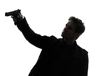one man killer policeman aiming gun silhouette studio white background