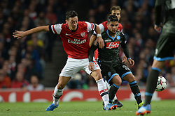 LONDON, ENGLAND - Oct 01: Arsenal's midfielder Mesut Ozil from Germany and Napoli's forward Lorenzo Insigne from Italy compete for the ball during the UEFA Champions League match between Arsenal from England and Napoli from Italy played at The Emirates Stadium, on October 01, 2013 in London, England. (Photo by Mitchell Gunn/ESPA)