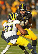 November 23 2013: Michigan Wolverines wide receiver Jeremy Gallon (21) tries to cut back to avoid Iowa Hawkeyes linebacker James Morris (44) on a run during the third quarter of the NCAA football game between the Michigan Wolverines and the Iowa Hawkeyes at Kinnick Stadium in Iowa City, Iowa on November 23, 2013. Iowa defeated Michigan 27-24. Iowa defeated Michigan 24-21.