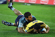 Hosea Gear dives in for a try, tackled by Rene Ranger. Super Rugby - Hurricanes v Blues at Westpac Stadium, Wellington, New Zealand on Friday 6th May 2011. PHOTO: Grant Down / photosport.co.nz