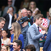 LONDON, ENGLAND - JULY 16: Hannah Bagshawe and Hugh Grant, Eddie Redmayne and Bradley Cooper at the Mens Singles Final between Roger Federer of Switzerland and Marin Cilic of Croatia during the Wimbledon Lawn Tennis Championships at the All England Lawn Tennis and Croquet Club at Wimbledon on July 16, 2017 in London, England. (Photo by Tim Clayton/Corbis via Getty Images)