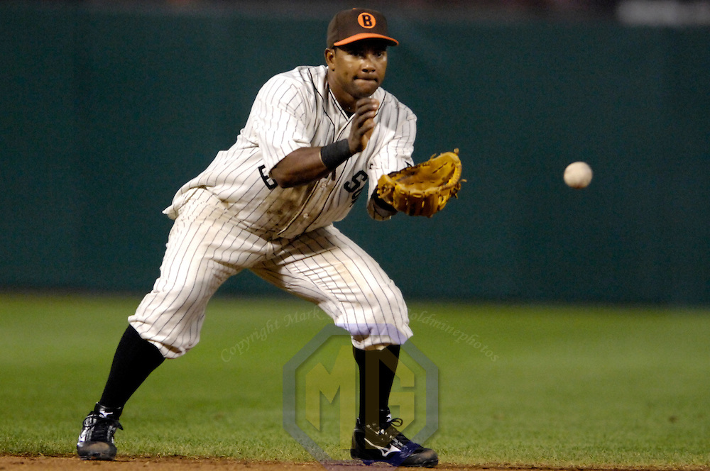06 September 2007:  Baltimore Orioles shortstop Miguel Tejada (10) fields a ground ball off the bat of Boston Red Sox third baseman Mike Lowell in the 5th inning.  The Orioles paid tribute to the 1932 Baltimore Black Sox by wearing replica uniforms during the game.  The Boston Red Sox defeated the Orioles 7-6 at Camden Yards in Baltimore, MD.