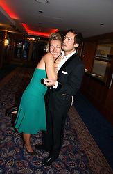 IAIN RUSSELL and MISS OLIVIA BUCKINGHAM at the Boodles Boxing Ball in aid of the sports charity Sparks  organised by Jez lawson, James Amos and Charlie Gilkes held at The Royal Lancaster Hotel, Lancaster Terrace London W2 on 3rd June 2006.<br /> <br /> NON EXCLUSIVE - WORLD RIGHTS