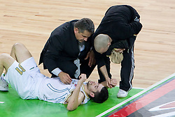 Dr. Oskar Zupanc and Miha Perko with Saso Ozbolt (31) of Olimpija injured  during basketball match between KK Union Olimpija (SLO) and Panathinaikos (GRE) in Group D of Turkish Airlines Euroleague, on November 4, 2010 in Arena Stozice, Ljubljana, Slovenia. Union Olimpija defeated Panathinaikos 85-84. (Photo By Vid Ponikvar / Sportida.com)