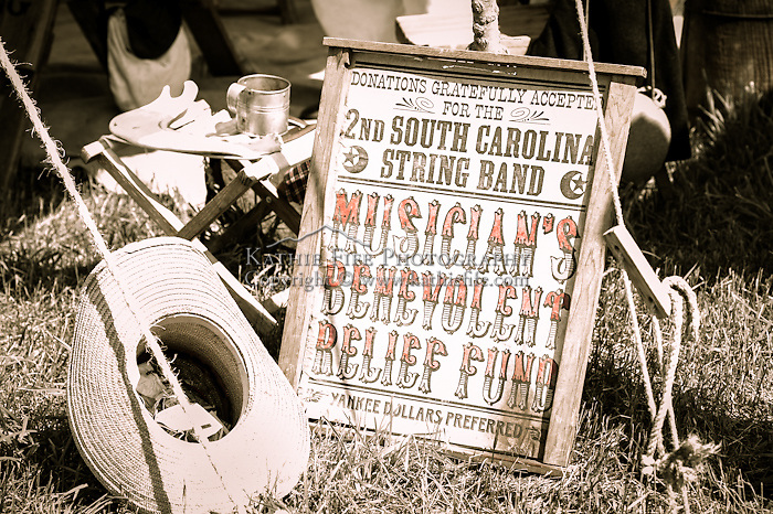 """A sign reads """"Donations gratefully accepted for the 2nd South Carolina String Band"""" at the Hillsborough Living History Event All Content is Copyright of Kathie Fife Photography. Downloading, copying and using images without permission is a violation of Copyright."""