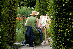A garden visitor on a painting course at Sissinghurst Castle Garden
