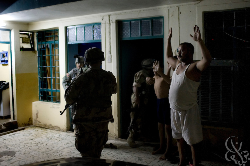 Iraqi Army 2nd Division soldiers backed by U.S. Forces conduct a joint raid of a home searching for a suspected terrorist financier 18, 2007 in Mosul, Iraq. Iraqi security forces in Mosul have taken over many of the day to day tasks of securing the city, allowing U.S. forces in the area to pull back and reduce its presence.