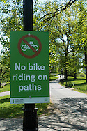 Signage in Central Park: No bike riding on the paths.