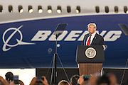 U.S. President Donald Trump standing in front of the new Boeing 787-10 Dreamliner aircraft addresses employees at the Boeing factory February 17, 2016 in North Charleston, SC. The visit comes two days after workers at the South Carolina plant voted to reject union representation in a state where Trump won handily.