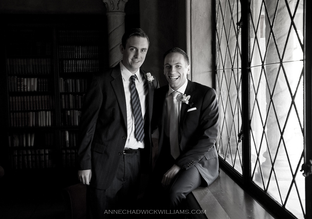 A groom and a groomsman pose at the Berkeley City Club before the wedding.