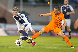 Scotland's Dominic Thomas (left) and Holland's Bart Ramselaar (right) battle for the ball during the 2019 UEFA Euro U21 Qualifying match at the St Mirren Park, Paisley.