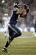 Seattle Seahawks outside linebacker Bruce Irvin (51) waves his arm as he celebrates after a fourth quarter sack for a loss of 8 yards during the NFL week 19 NFC Divisional Playoff football game against the Carolina Panthers on Saturday, Jan. 10, 2015 in Seattle. The Seahawks won the game 31-17. ©Paul Anthony Spinelli