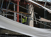 © Licensed to London News Pictures. 29/04/2012. London, UK . A workman at the scene. Heavy winds have caused a large section of scaffolding to collapse on building work being carried out for a new Jamie Oliver restaurant on Notting Hill Gate in West London today 29th April 2012. The structure came down at approx 0300am across a main road junction and nobody was hurt. The  Photo credit : Stephen Simpson/LNP