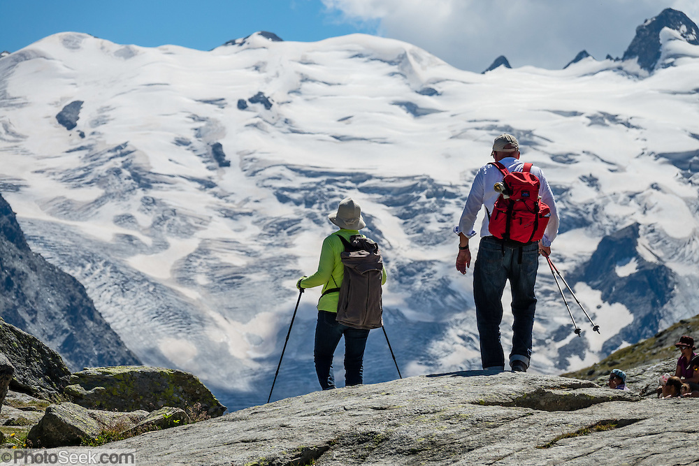 "Hike from Pontresina up Roseg Valley to Fuorcla Surlej for stunning views of Piz Bernina and Piz Rosegg, finishing at Corvatsch Mittelstation Murtel lift. Walking 14 km, we went up 1100 meters and down 150 m. Optionally shorten the hike to an easy 4 km via round trip lift. Pontresina is in Upper Engadine, in Graubünden (Grisons) canton, Switzerland, the Alps, Europe. The Swiss valley of Engadine translates as the ""garden of the En (or Inn) River"" (Engadin in German, Engiadina in Romansh, Engadina in Italian)."