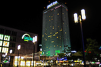 Berlin, Germany. Alexanderplatz at night. Galeria Kauphof shopping mall and Park Inn hotel.