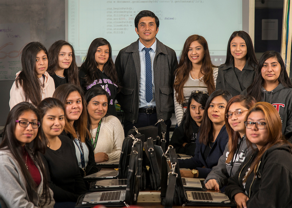 Jose Guevara poses for a photograph with coding students at Northside High School, January 5, 2017.