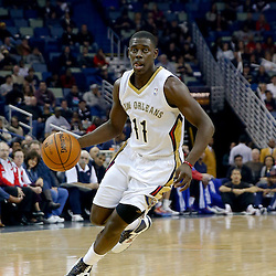 Dec 11, 2013; New Orleans, LA, USA; New Orleans Pelicans point guard Jrue Holiday (11) against the Detroit Pistons during the first quarter at New Orleans Arena. Mandatory Credit: Derick E. Hingle-USA TODAY Sports