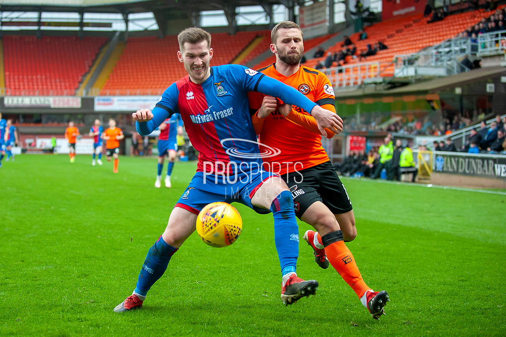 Jamie McCart (#6) of Inverness Caledonian Thistle FC shields the ball from Pavol Safranko (#14) of Dundee United FC during the William Hill Scottish Cup quarter final match between Dundee United and Inverness CT at Tannadice Park, Dundee, Scotland on 3 March 2019.
