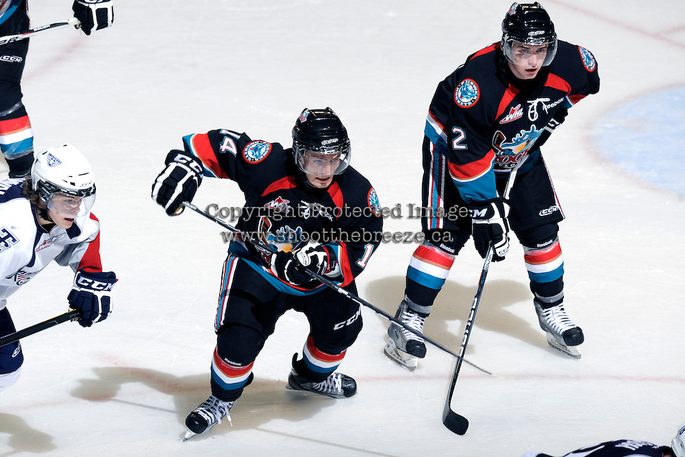 KELOWNA, CANADA, OCTOBER 5: Cody Chikie #14 and Jesse Lees #2 of the Kelowna Rockets skate on the ice against the Tri City Americans on October 5, 2011 at Prospera Place in Kelowna, British Columbia, Canada (Photo by Marissa Baecker/shootthebreeze.ca) *** Local Caption ***Cody Chikie;Jesse Lees;