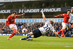 Tottenham's Michael Dawson stops a shot from Cardiff's Fabio  - Photo mandatory by-line: Mitchell Gunn/JMP - Tel: Mobile: 07966 386802 02/03/2014 - SPORT - FOOTBALL - White Hart Lane - London - Tottenham Hotspur v Cardiff City - Premier League
