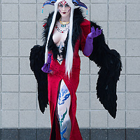 London, UK - 15 March 2014: a Kyokyo cosplayer dressed as  Ultimecia from Final Fantasy 8 poses for a picture during the London Super Comic Con at Excel.
