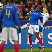 PARIS, FRANCE - March 25:  Paul Pogba #6 of France and Birkir Mar Sævarsson #2 of Iceland challenge for the ball during the France V Iceland, 2020 European Championship Qualifying, Group Stage at  Stade de France on March 25th 2019 in Paris, France (Photo by Tim Clayton/Corbis via Getty Images)