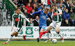 George Cooper of Peterborough United in action with Gary Sawyer and Jamie Ness of Plymouth Argyle - Mandatory by-line: Joe Dent/JMP - 07/04/2018 - FOOTBALL - Home Park - Plymouth, England - Plymouth Argyle v Peterborough United - Sky Bet League One