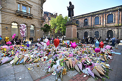 May 25, 2017 - Manchester, Manchester, United Kingdom - Image ©Licensed to i-Images Picture Agency. 25/05/2017. Manchester, United Kingdom. Manchester Terror attack- Day Three. Flowers placed  in St Ann's Square in the centre of Manchester, laid to respect those who died in the terrorist attack on Manchester Arena on Monday 22nd May, 2017. Manchester Arena was targeted by suicide bomber Salman Abedi's, killing 22 people.  Picture by Andrew Parsons / i-Images (Credit Image: © Andrew Parsons/i-Images via ZUMA Press)