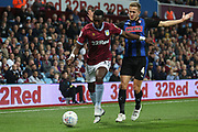 Yannick Bolasie of Aston Villa (11) gets away from Will Vaulks of Rotherham United (4) during the EFL Sky Bet Championship match between Aston Villa and Rotherham United at Villa Park, Birmingham, England on 18 September 2018.